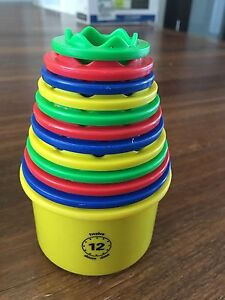Discovery toys - measure up cups.