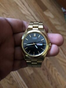 Gold citizen watch