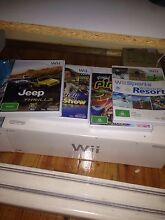 Wii console + 4 games + Controller and nunchuck Croydon Charles Sturt Area Preview