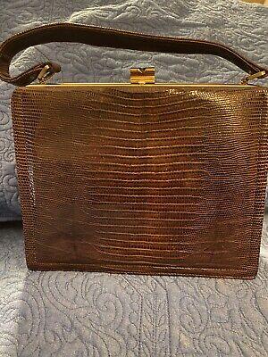 1950s Handbags, Purses, and Evening Bag Styles Vintage Escort Bag 1950s Brown Lizard Skin Handbag With Goldtone Clasp Closure $45.99 AT vintagedancer.com