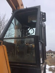 Case 880R rubber tired excavator for sale.