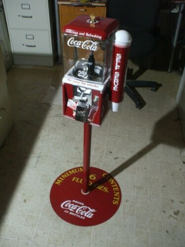 NW Coca-Cola theme gumball candy machine with glass globe cup holder & stand