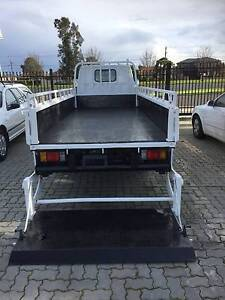 ISUZU DROP SIDE TRAY WITH 2 TON TAIL GATE LOADER Springvale Greater Dandenong Preview
