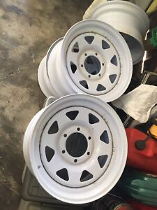 ON HOLD x4 16x8 steel rims in white.