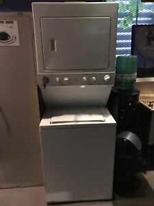"Stacked 27""w 72""h Washer dryer  working"