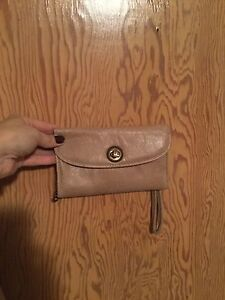 Roots stone Color leather wallet.