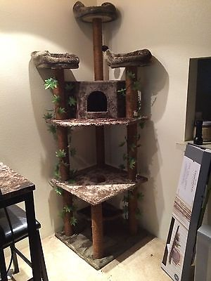 - Cat Tower, Kitty Jungle; Brown with fake green ivy leaves.
