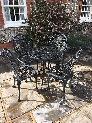 Metal garden furniture patio set - small round table and 4 matching chairs.