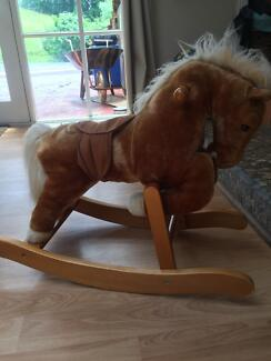 Rocking Horse (with neighing and galloping sounds) - like new.