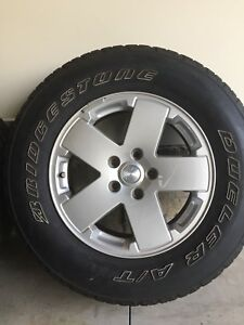 5 Jeep tires and rims