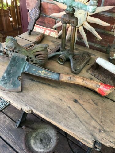 Antique official boy Scouts of America hatchet with leather sheath