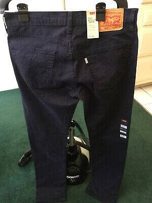 LEVI'S 502 REGULAR TAPER STRETCH FIT JEANS. SIZE -33 X 34.NAVY BLUE.