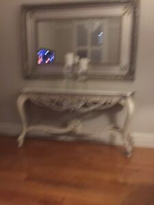 French Provincial console table with silver leaf trims