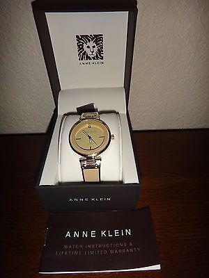 Anne Klein AK/2302TNGB Womens Gold Tone/Beige Watch~Beige Dial~Diamond Chip~34mm