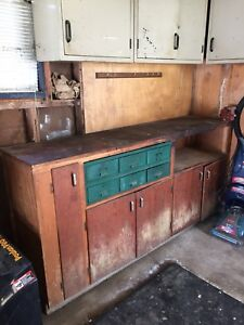 Work bench, metal cabinets and  shelving. Reduced