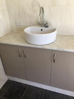 bathroom vanity with sink cupboards and tapware