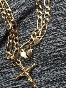 Solid 10k gold figaro chain and pendent.