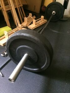 Barre olympique avec bumper plates