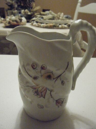 WHITE PITCHER WITH ROSE YELLOW CREAM FLOWERS WITH HANDLE A BIT WORN