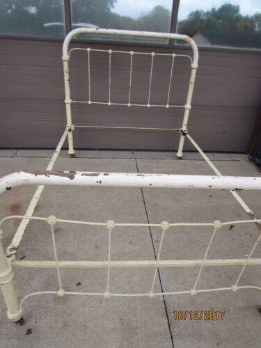 antique ornate iron bed frame w/ taper cone pin rails