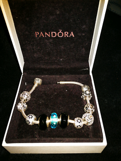 Genuine Pandora bracelet with charms