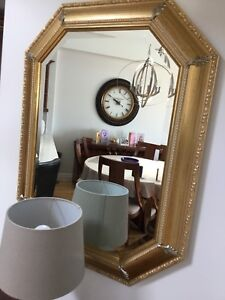 Gold frame wall mirror.