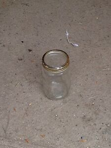 Approx 48 wide mouth Quart jars ,rack,tings,canner