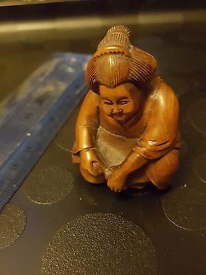 netsuke - crouching lady, signed