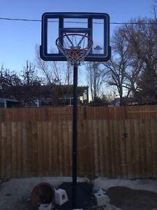 Weighted, freestanding basketball net