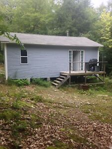 24x30 camp for sale( 1 acre)( queens  county)