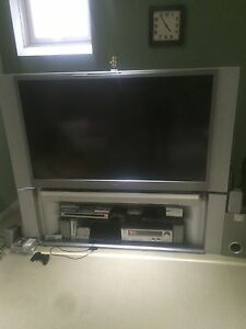 55 inch Tv Toshiba with surround sound speakers and more!!!