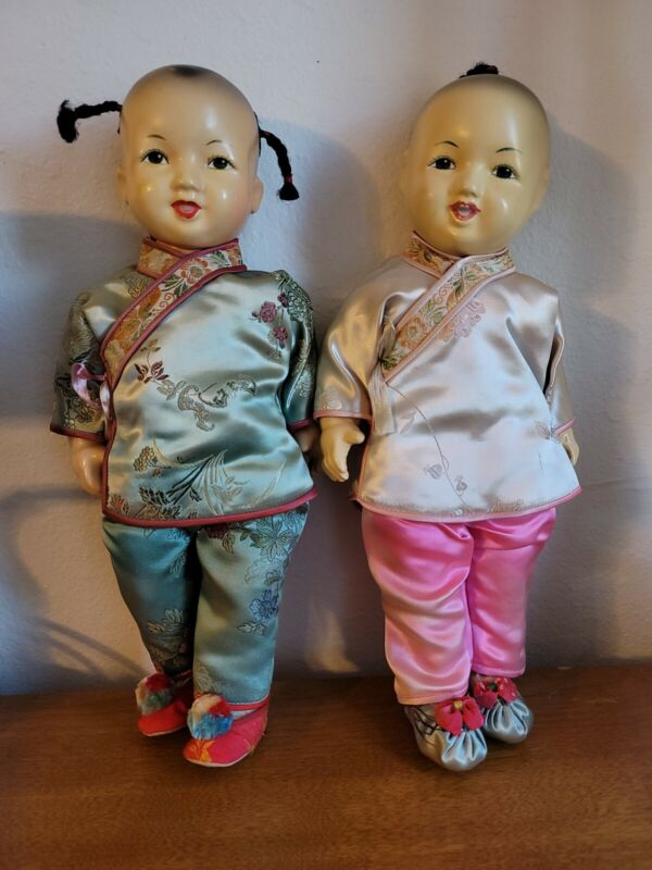 Vintage Chinese Porclein Dolls Hand Painted Faces 13 1/2 inches tall.
