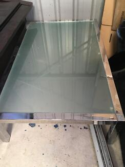Excellent condition glass and steel coffee table