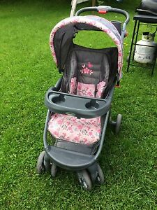 Stroller and infant carrier/base