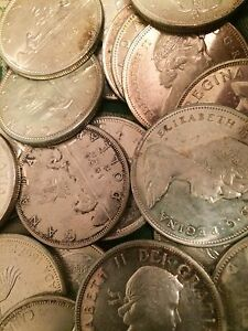 100 Canadian Silver Dollars