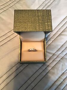 Selling a white gold 1.00 CT time engagement ring.