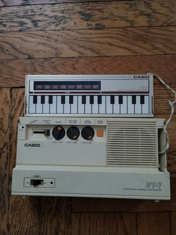 Casio PT-7 Electronic Musical Instrument with Polyphonic Touch Sensor Keypad...