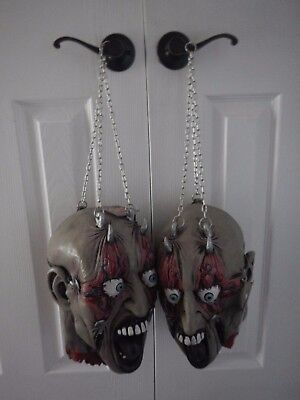 Set of 2 Forum Novelties Severed Demon Cut Off Heads Bloody Hanging Chains - Wholesale Halloween Props