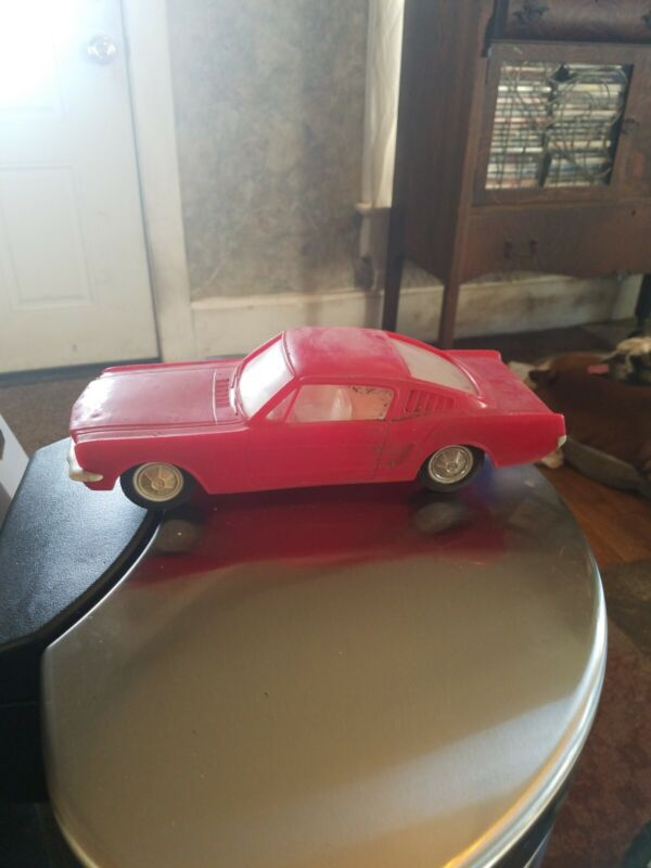 Vintage Red Plastic Two Door Ford Mustang