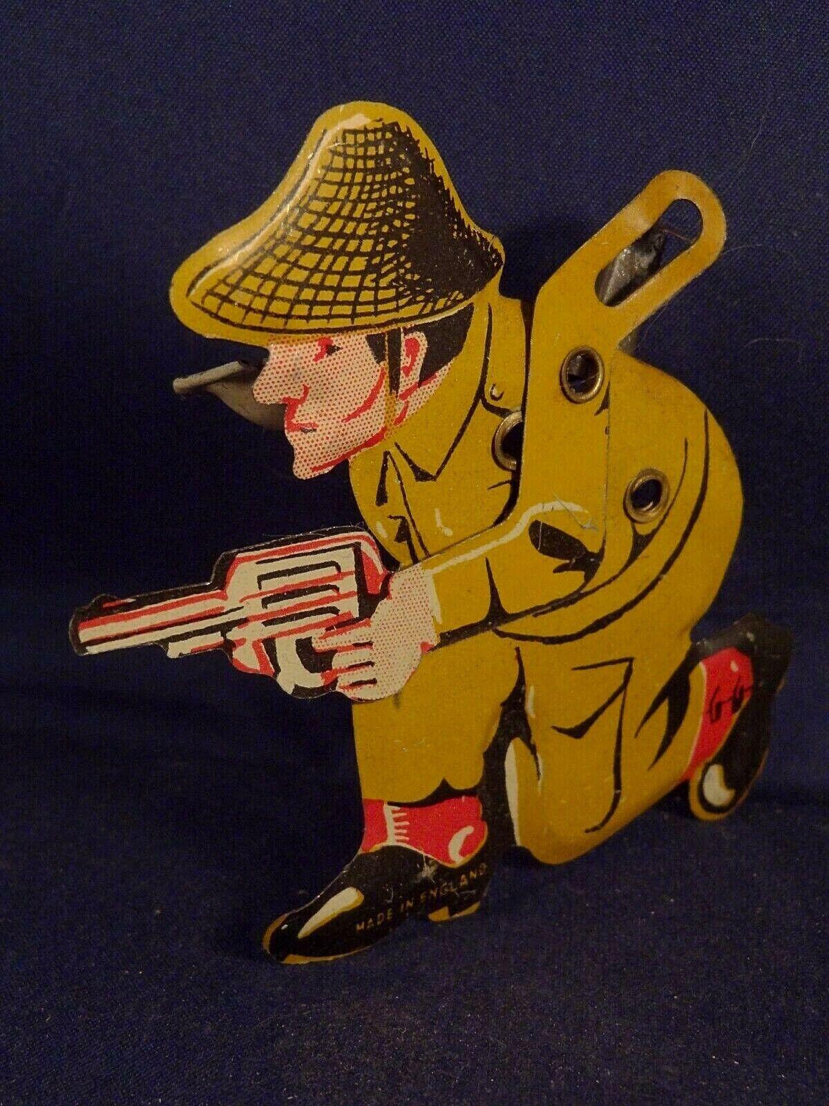 Ancien jeu jouet tôle lithographiée clic-clac cri-cri militaire soldat anglais