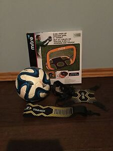 Soccer net and ball and SKLZ STAR KICK
