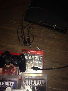 PS3 two controllers and games London Ontario image 3