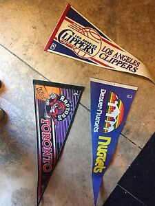 Vintage sports flags seven dollars each