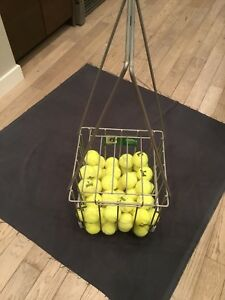 Tennis ball hopper holds 110 balls