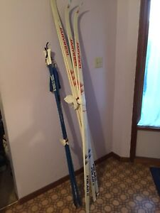 2 Pairs of cross country skis and poles