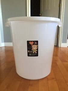 3 large white garbage cans