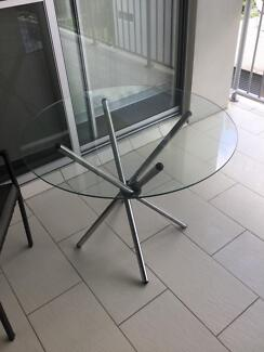 Besutiful little round glass table