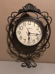 Howard Miller Nicole 625-327 Wrought iron wall clock with bent iron scroll work
