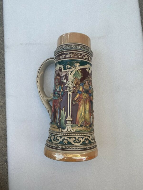 Vintage German Beer Stein  Approximately 12 Inches tall.
