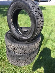 Good year Nordic winter tires 215 65 r16 barely used!